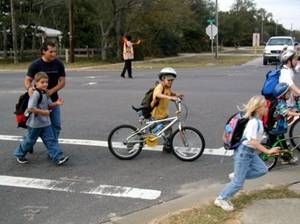 Cycling - ASRTS - child cycling across street