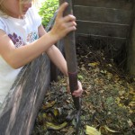 Turning the compost bin