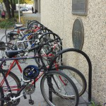 U racks too close to buildings makes maneuvering difficult and reduces capacity.
