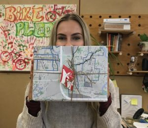 holiday gift wrapped in a 2012 cycling map, with a gift tag made out of an old card!